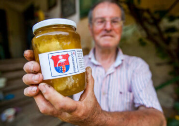 Man holding jar of locally made produce