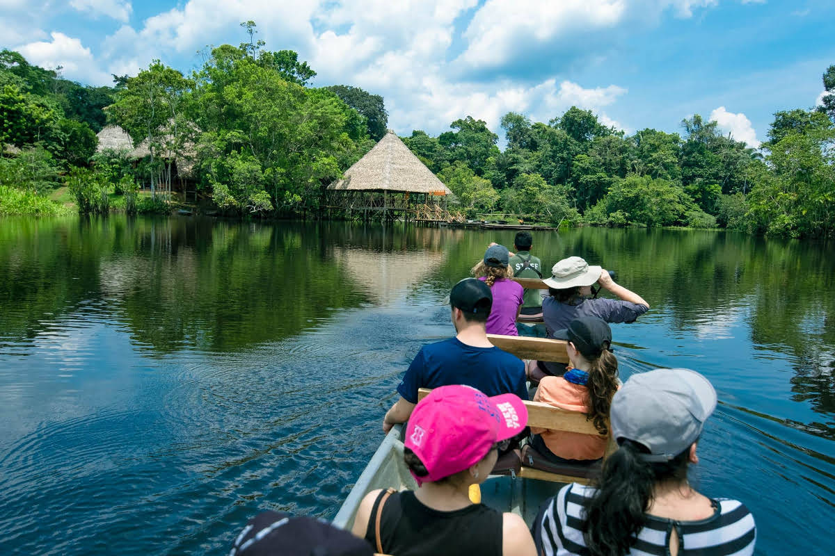 Group of tourists on an amazon river boat trips at Sani lodge ecolodge in Ecuador