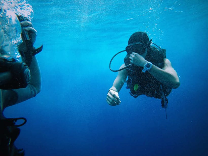 Scuba Diver Equalising, like the skills learnt in Open Water Diving Courses